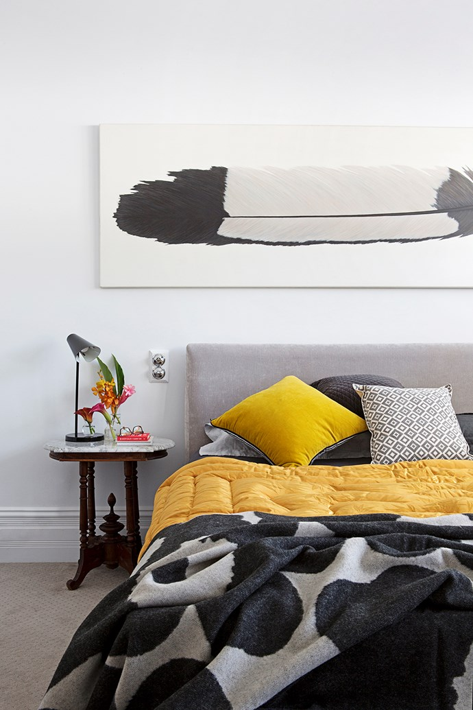 """The feather artwork was picked up in Hong Kong, while the side tables are from Singapore. Bedside lamp from [Living Edge](http://www.livingedge.com.au/?utm_campaign=supplier/