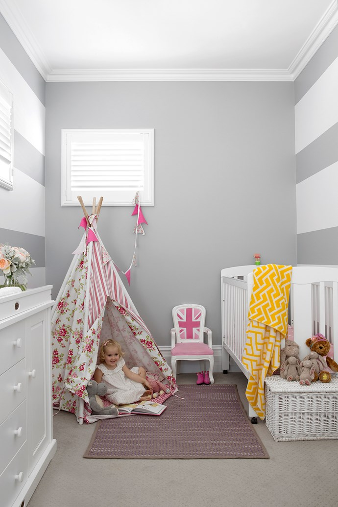 """In youngest daughter Grace's room, dove grey walls form the perfect backdrop for white nursery furniture and a cute pink **tepee** from [Mocka](http://www.mocka.com.au/?utm_campaign=supplier/
