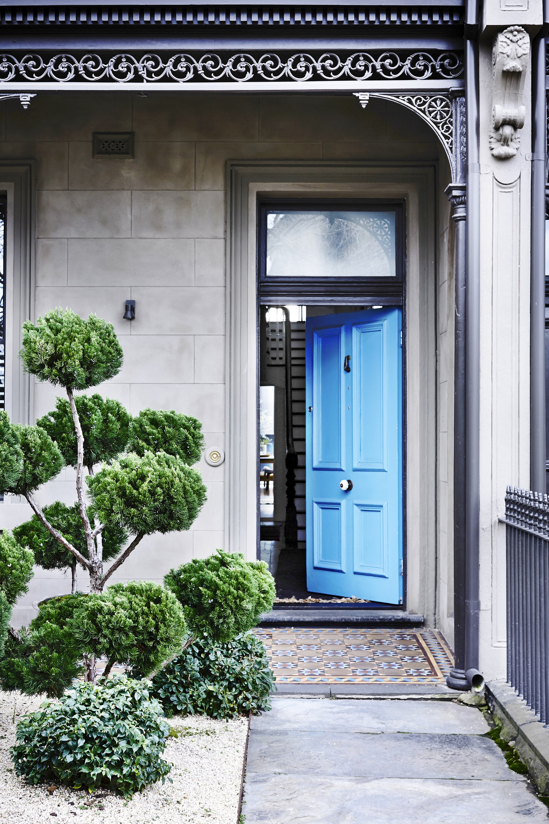 "The elegantly sculpted Chinese juniper and front door painted in [Porter's Paints](http://www.porterspaints.com?utm_campaign=supplier/|target=""_blank"") Westport Blue hint at the design surprises inside."