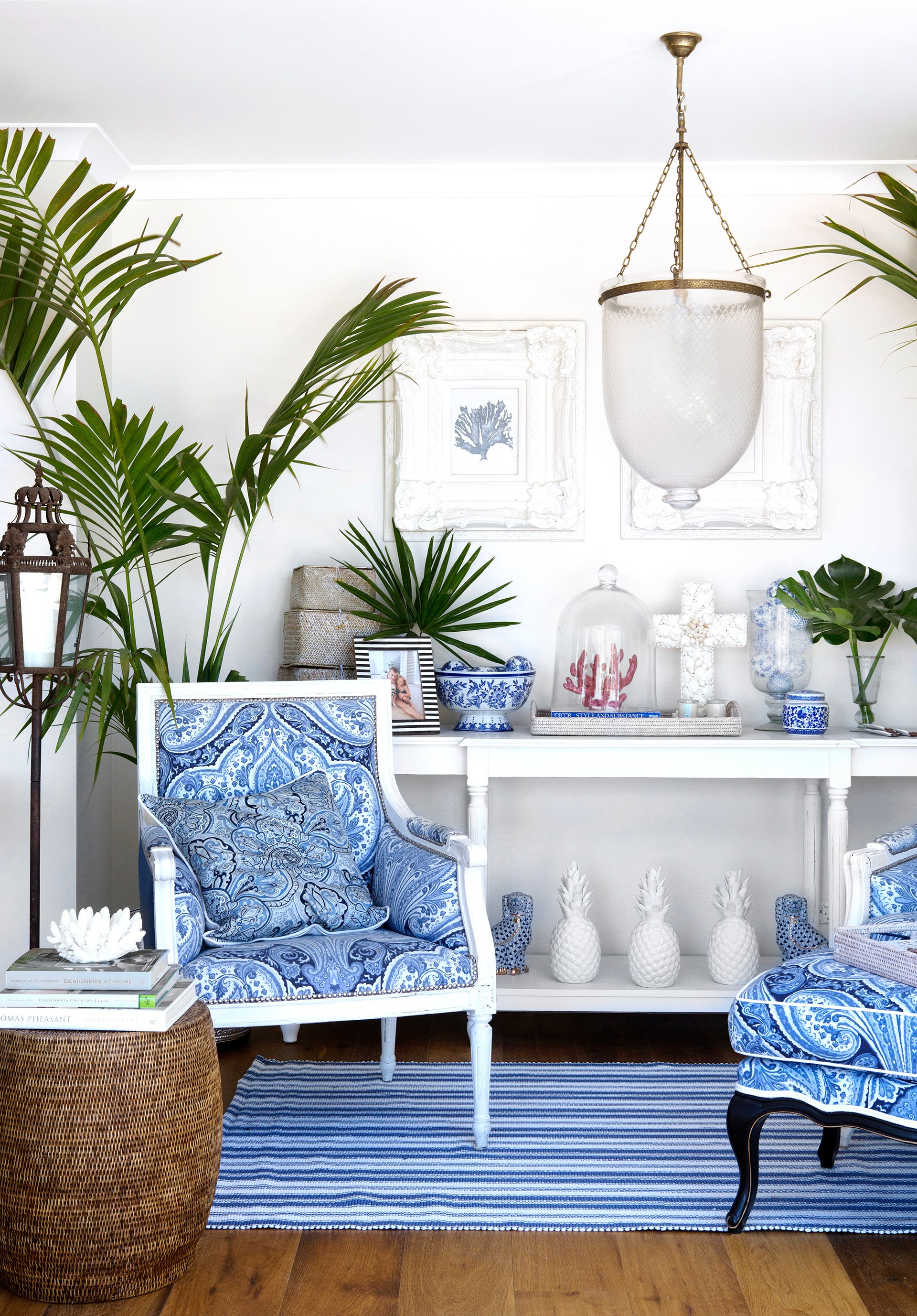 """Natalee had antique armchairs repainted and upholstered in blue-and-white fabrics that reference her collection of classic ceramics.   Rattan **stools** from [Mandalay Designs](http://mandalaydesigns.com.au/?utm_campaign=supplier/