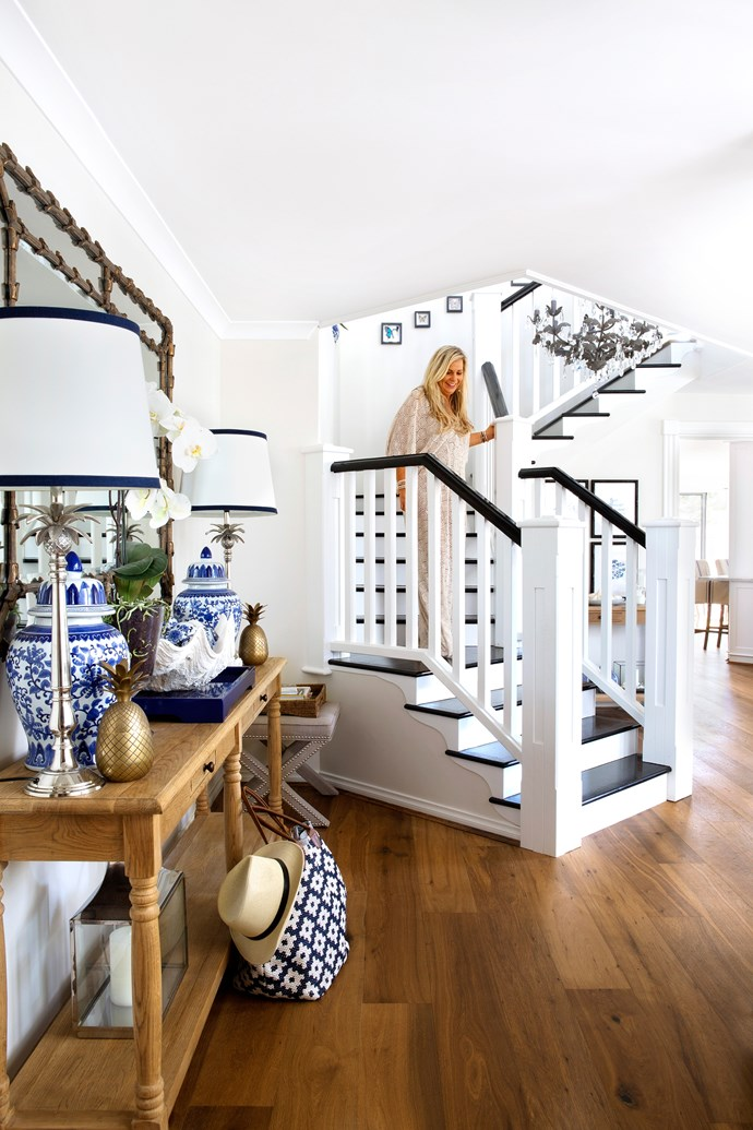 "Natalee descends the elegant central staircase.  **Console** and **mirror** from [Restoration Hardware](https://www.restorationhardware.com/?utm_campaign=supplier/|target=""_blank""). **Pendant light** from [Troy Lighting](http://www.lightco.com.au/?utm_campaign=supplier/
