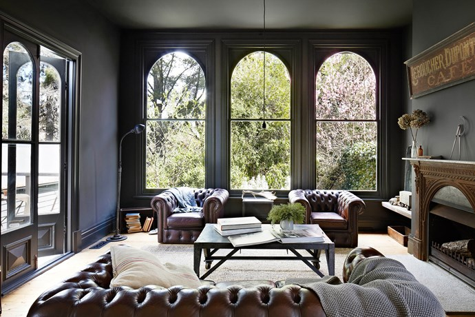 Vintage House Daylesford is full of amazing fossicked furniture. Who wouldn't want to sit in these leather chesterfield sofas and enjoy a glass of wine by the 1800's cast-iron fireplace from France? Photo: Armelle Habib | Styling: Julia Green
