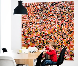 Indigenous artwork in dining room with a toddler