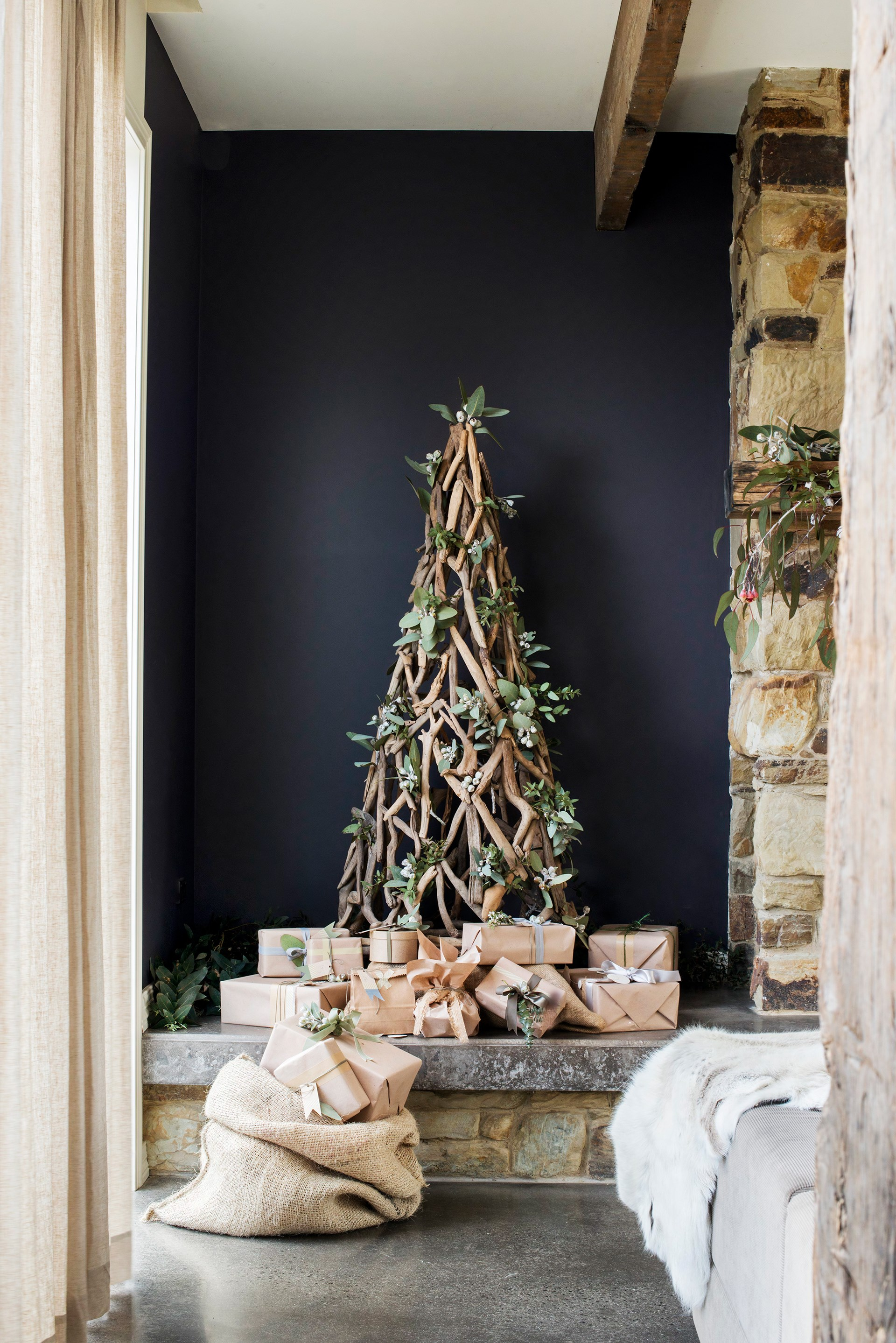 "Nestled among gum trees with plenty of rustic Christmas charm, this [newly built family home](http://www.homestolove.com.au/tim-and-joannes-rustic-stone-cottage-2533|target=""_blank"") looks as though it's been standing for 100 years. Photo: Nikole Ramsay / *Australian House & Garden*"