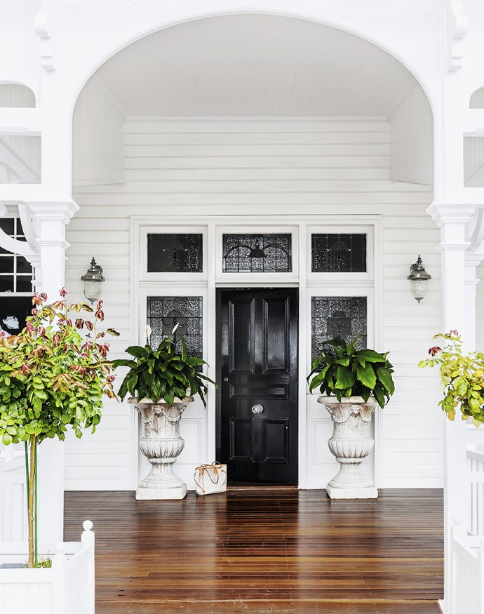 """The front door and surrounding stained glass are all original. The bespoke light fittings from [Highgate House](http://www.highgatehouse.com.au/?utm_campaign=supplier/