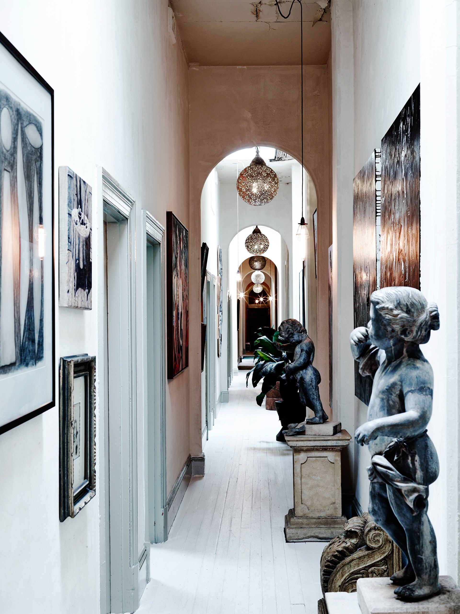 The 63-metre-long hallway hosts French cupids, Indian lights, a McLean Edwards drawing and a Clinton Nain painting.