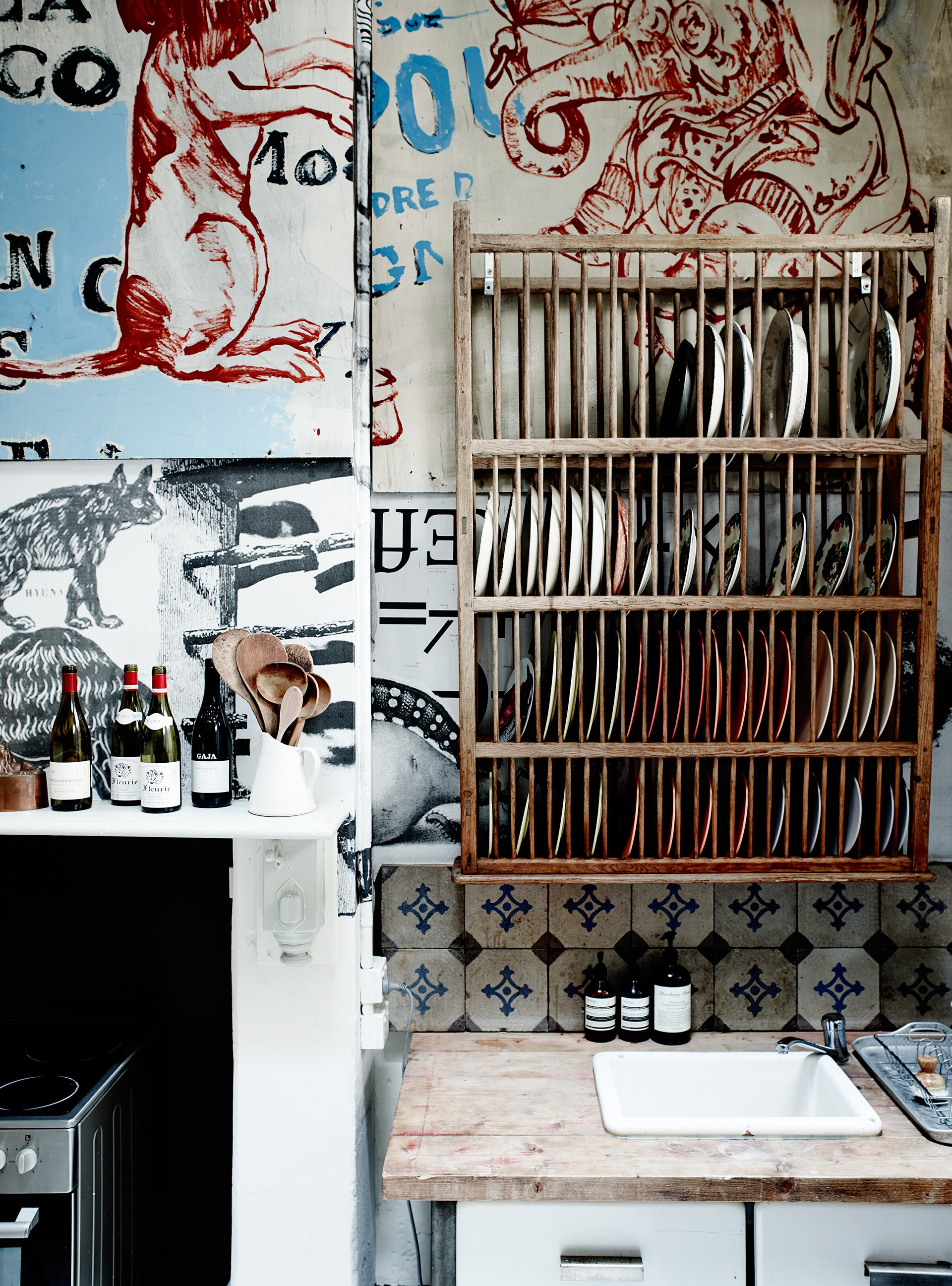 A French plate rack and David Bromley mural add character to the kitchen.