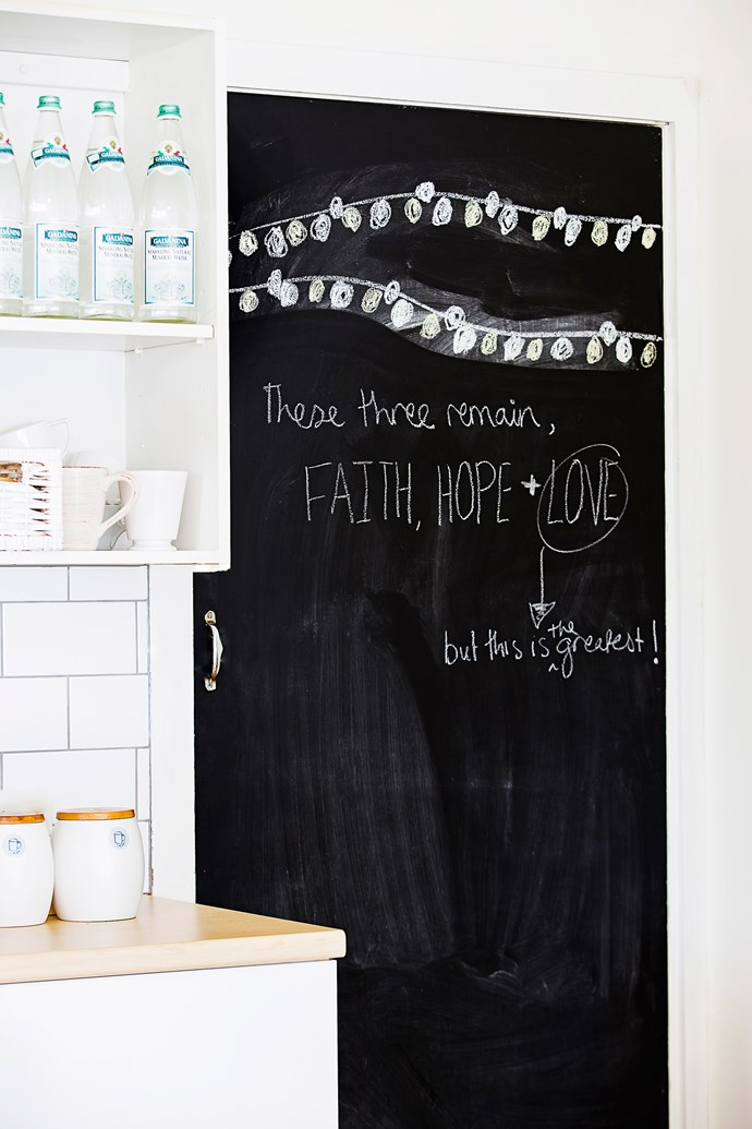 Chalkboard paint in the kitchen provides a spot for fun notes and shopping lists.