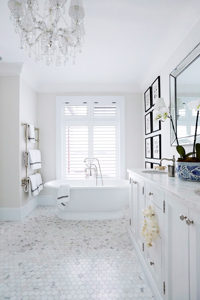 Plantation shutters are an excellent privacy option for bathrooms as they are easy to open and shut. Photo: John Paul Urizar