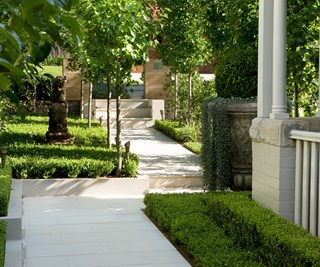 Formal sandstone paved garden entrance