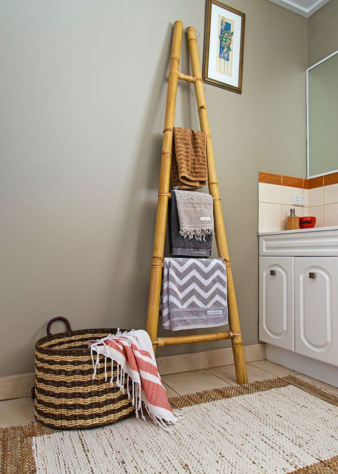 An attractive laundry basket and towel ladder encourage tidiness in the bathroom.
