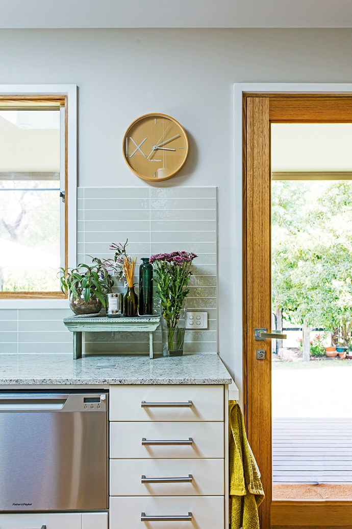 """We chose high-gloss glass tiles for the splashback – we love the neutral colour,"" Judy says."