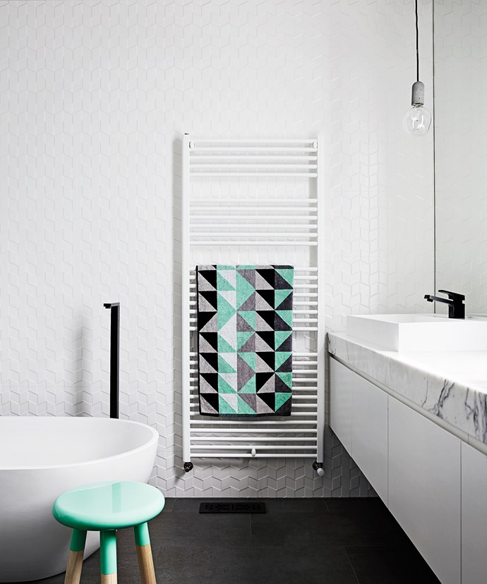 """Minty fresh Italian ceramic wall tiles and a double vanity with calacatta marble benchtop scream elegance in the bathroom, while black tapware from [Reece](http://www.reece.com.au/?utm_campaign=supplier/