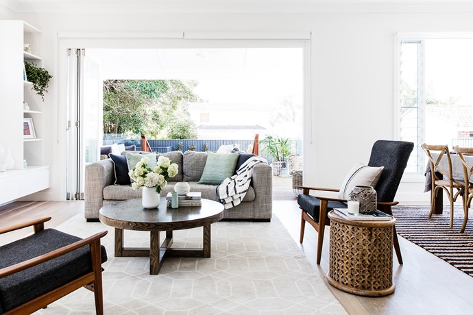 "Concertina doors from the rear living area lead to an outdoor kitchen and barbecue area and a north-facing outdoor room. Coffee table and custom-made sofa, [Beachwood Designs](http://www.beachwood.com.au/?utm_campaign=supplier/|target=""_blank""). Restored vintage armchairs were a gift to Anna from Matt. Rug, [Pottery Barn](http://www.potterybarn.com.au/?utm_campaign=supplier/