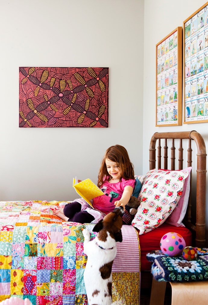 Jane's daughter and the family's Jack Russell share a moment in her colourful bedroom.