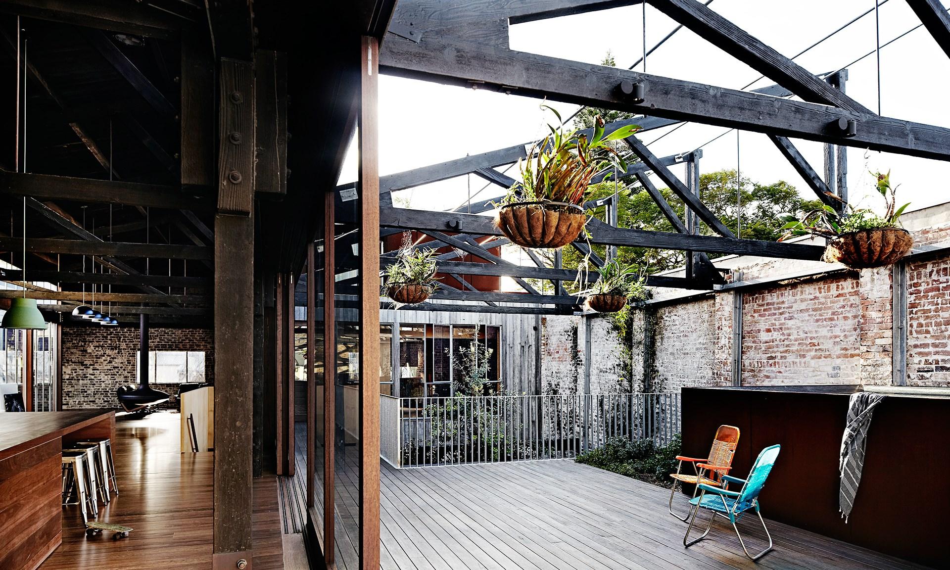 [Merrick Watts' sleek and stylish warehouse conversion](http://www.homestolove.com.au/inside-comedian-merrick-watts-happy-home-3465). Photo: Sharyn Cairns / *real living*