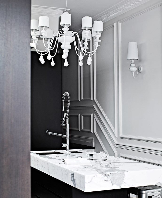 Calacatta marble is encased around the island bench to create the illusion of depth.