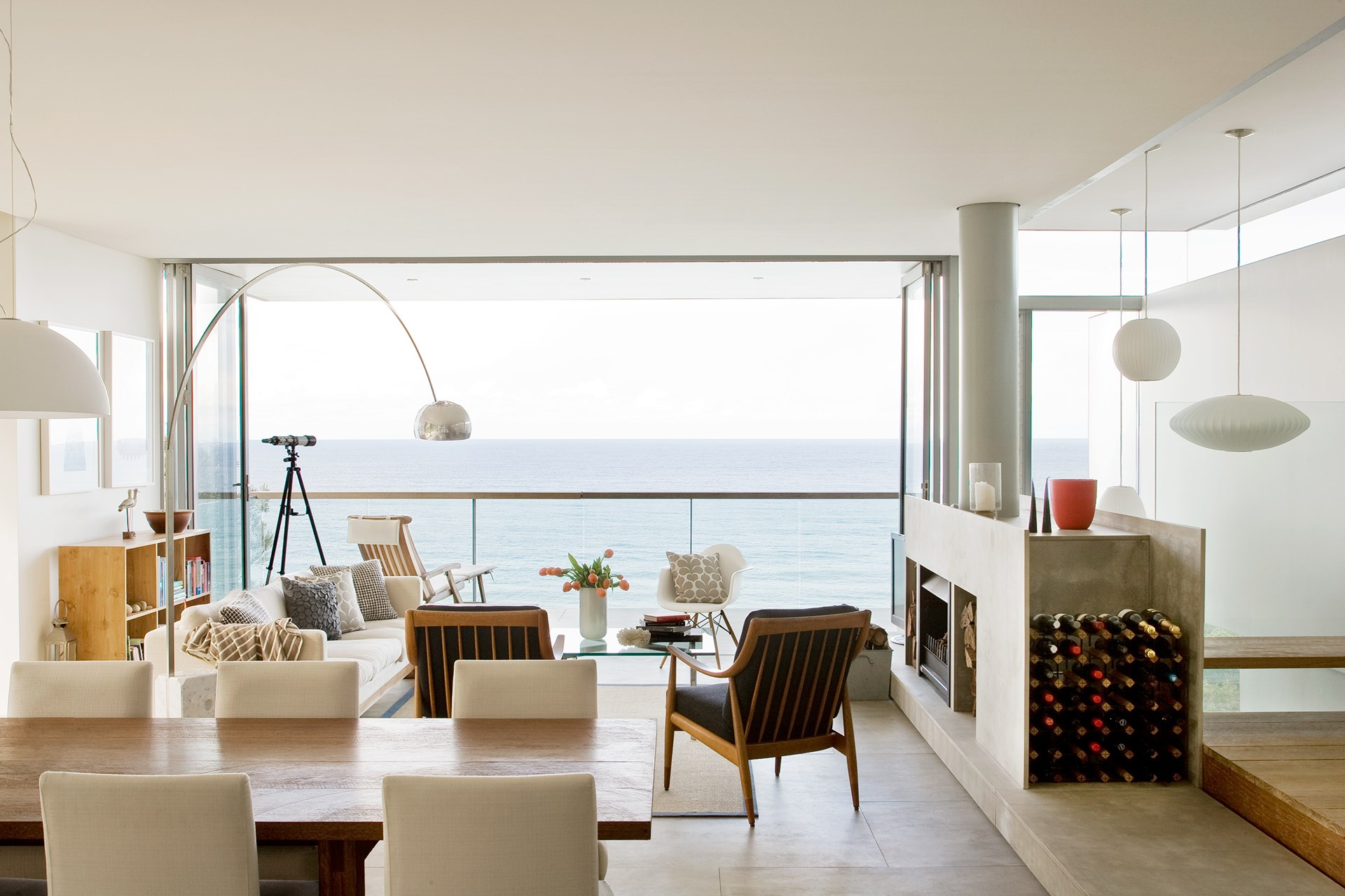 """The ocean vista is the star attraction of this home and every seat in the house provides a wonderful vantage point. """"From the bench on the landing, you get a view across the void out to the ocean,"""" says Alison."""