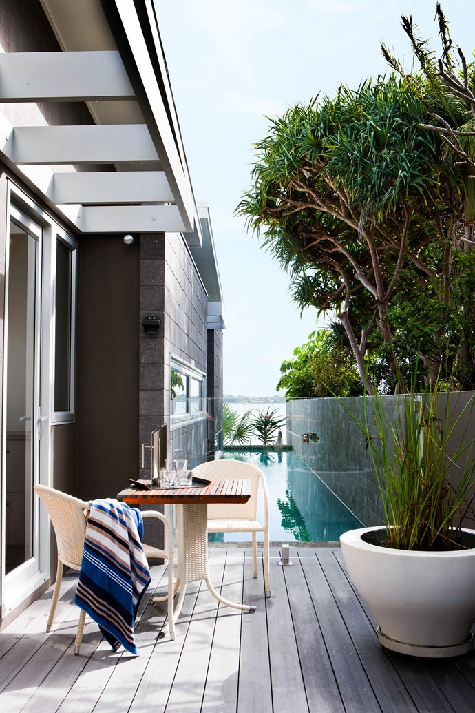 One bedroom opens onto a deck, the perfect place for drying out after a swim. The planter was found at a garage sale.