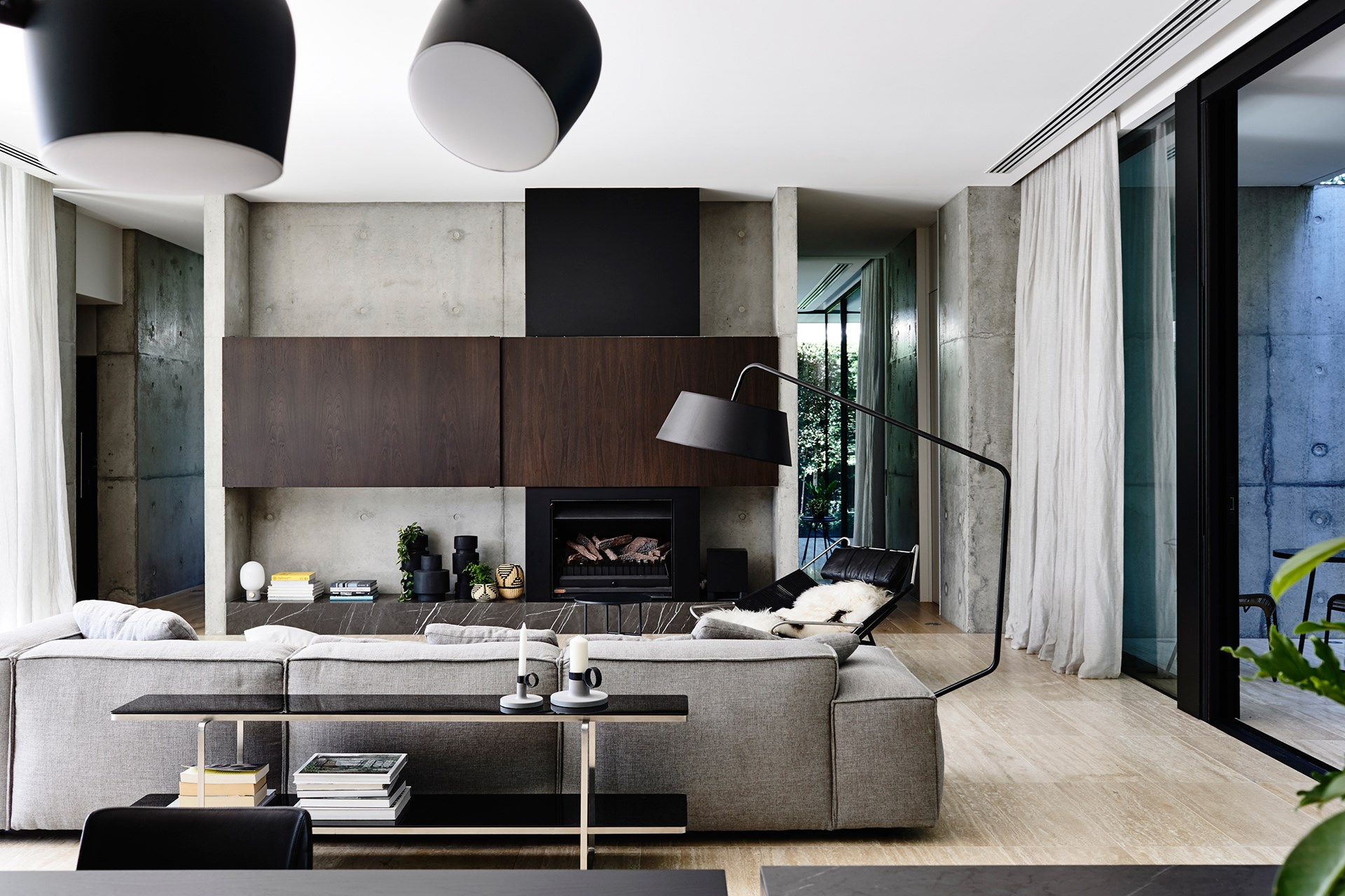 Texture and form, rather than colour, give the living room its appeal.