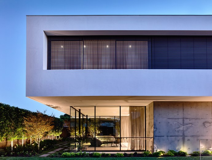 The outside of the house appears quite austere, belying the warmth and tactility inside.