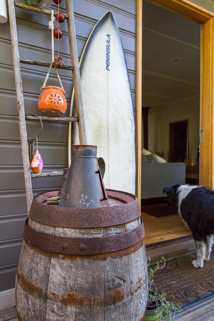 Judy loves to repurpose items, like this family heirloom ladder and an old wine barrel.