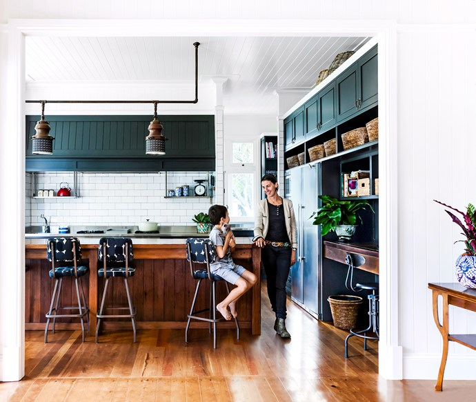 """A potent shade of petrol-blue creates contrast and depth in the kitchen of this [busy family home](http://www.homestolove.com.au/gallery-bettina-and-davids-renovated-queenslander-2224