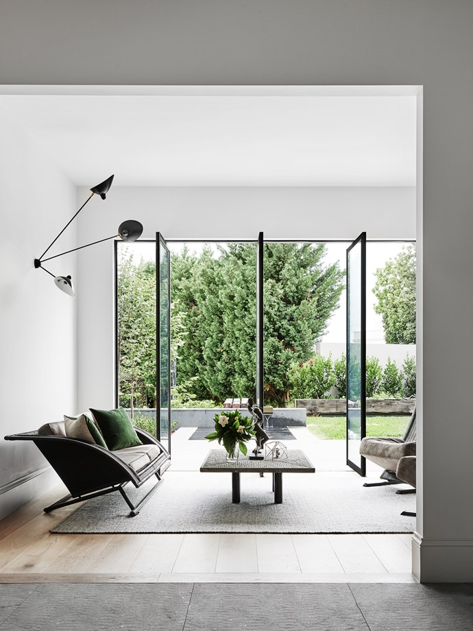 "New, expansive, floor-to-ceiling steel-framed glass pivot doors overlook a garden landscaped by [Jack Merlo](http://jackmerlo.com/?utm_campaign=supplier/|target=""_blank"")."
