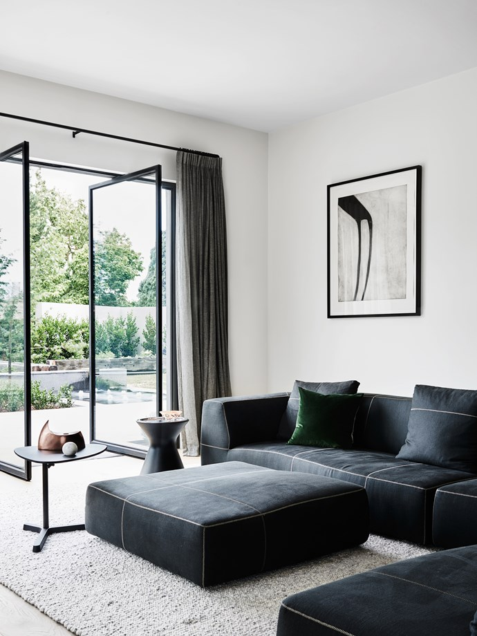 """""""The limited palette creates a harmonious flow from room to room, and lets the new steel windows and doors create the texture and patterning to the interior fabric, similar to a Scottish tartan,"""" says Kathryn."""