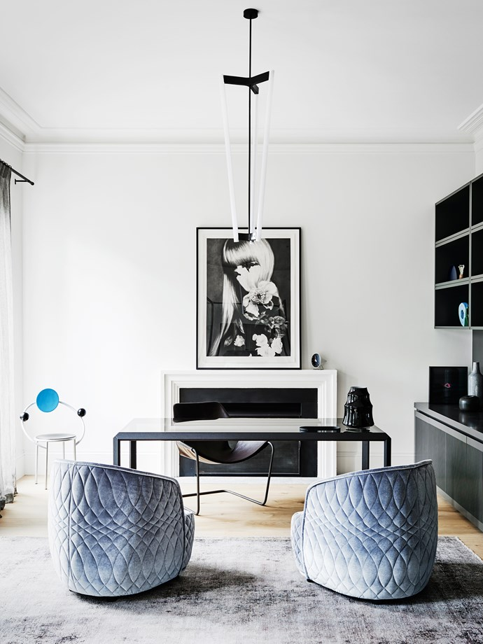 """The study is decorated with dusty blue velvet [Moroso](http://www.moroso.it/?lang=en/?utm_campaign=supplier/ target=""""_blank"""") 'Redondo' armchairs and a smoky-hued rug from [Halcyon Lake](http://halcyonlake.com/?utm_campaign=supplier/ target=""""_blank"""")."""