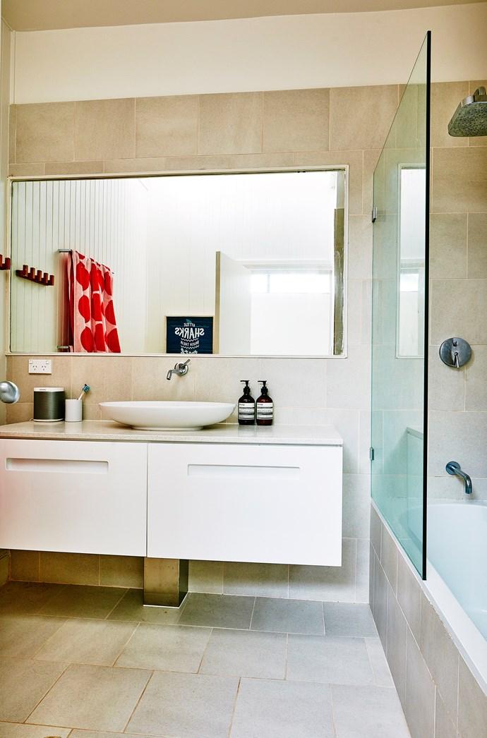 "A wall-hung vanity and large mirror make the [bathroom](http://www.homestolove.com.au/6-budget-bathroom-updates-3599|target=""_blank"") seem bigger."