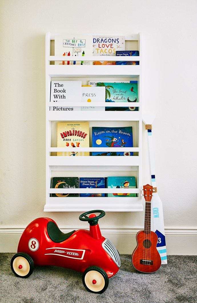 """A book rack displays book covers like artwork. This one is from [Willow & Wood](http://willowandwood.com.au/