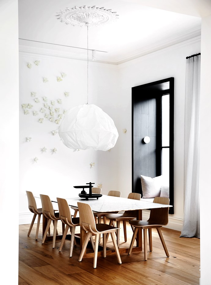 "A custom marble and oak dining table from Lowe Furniture with 'Kuskoa' chairs from [Cosh Living](http://www.coshliving.com.au/|target=""_blank""). 'Yokohama' pendant light by Georg Baldele."