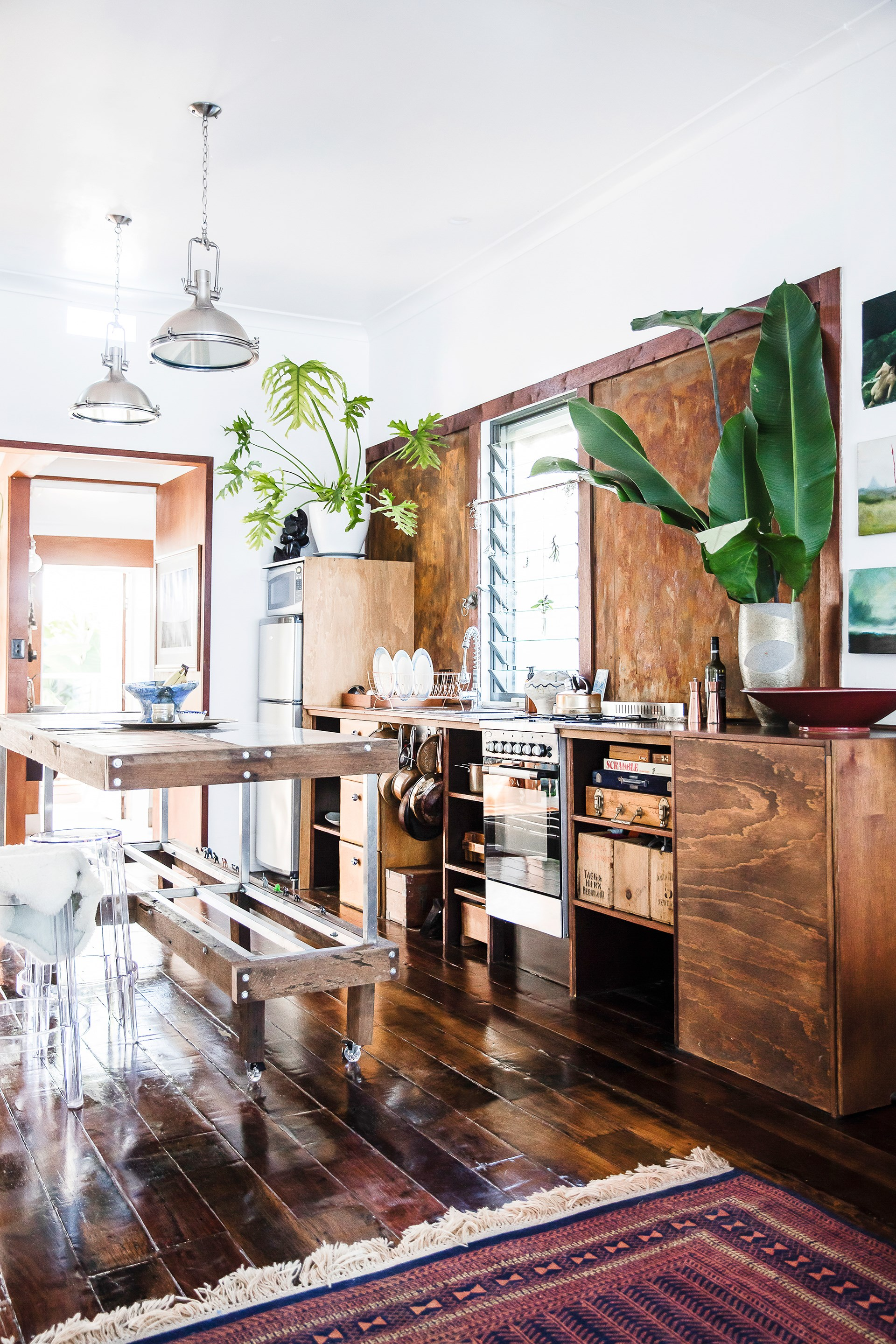"When you strip a kitchen down to the most basic materials you can create a space that feels more like an interior and less like a page out of a hardware catalogue. The owners of this rustic [Newcastle home](http://www.homestolove.com.au/boho-style-house-tour-in-newcastle-4051|target=""_blank"") haven't used tiles, splashbacks or rangehoods – creating a room with a whole lot of warmth."
