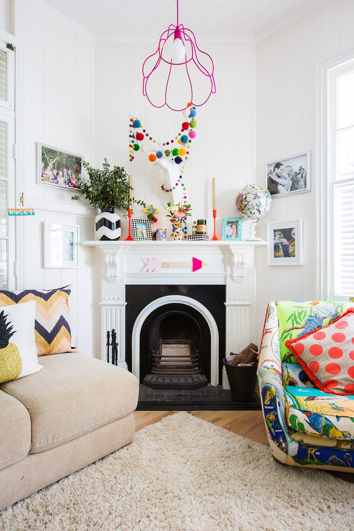 The mantelpiece hosts a collection of treasures from the couple's time abroad.