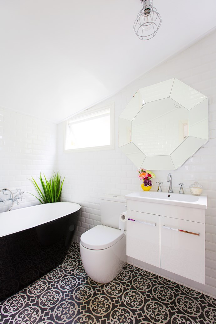The renovated bathroom stays true to the home's old-time character whilst adding a refreshing modern touch.