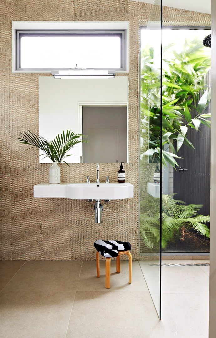**Break the rules.** Ditch large-format tiles and use lightly-hued mosaic tiles to complement a small space. If you have the privacy, consider a glass wall, too. These combined features will really help to maximise your space. *Photo: Armelle Habib / bauersyndication.com.au*