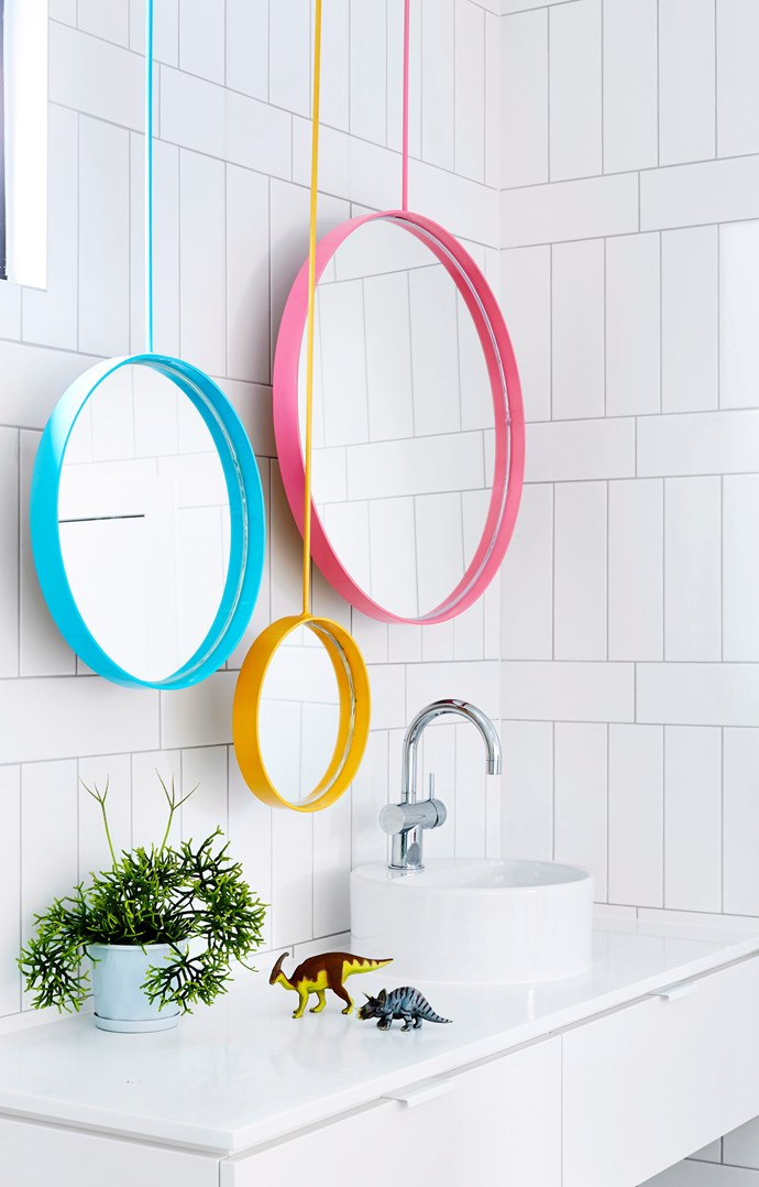 **Multiple mirrors.** In a tight space, having more than one mirror can allow multiple people to get ready at once. Using pop colours and different sized mirrors also helps to make a big impact in a small space. *Photo: Derek Swalwell / bauersyndication.com.au*