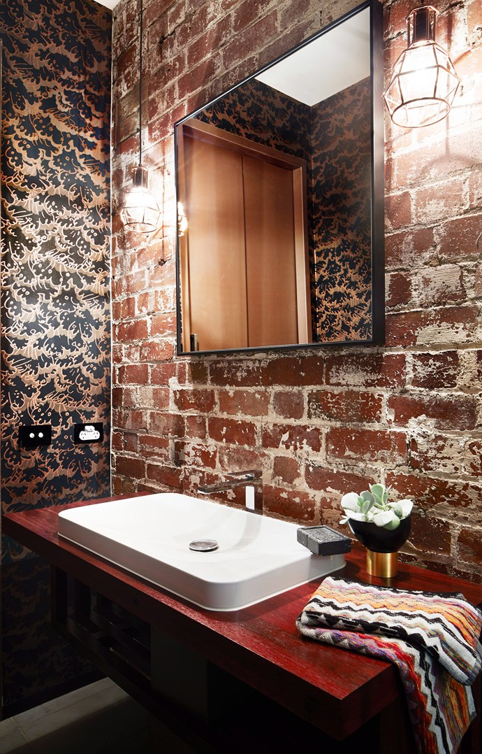 **Brighten up.** Exposed brickwork and patterned walls aren't off the table in small spaces. Just ensure that you have plenty of overhead or pendant lighting to keep your bathroom bright and airy. *Photo: Armelle Habib / bauersyndication.com.au*
