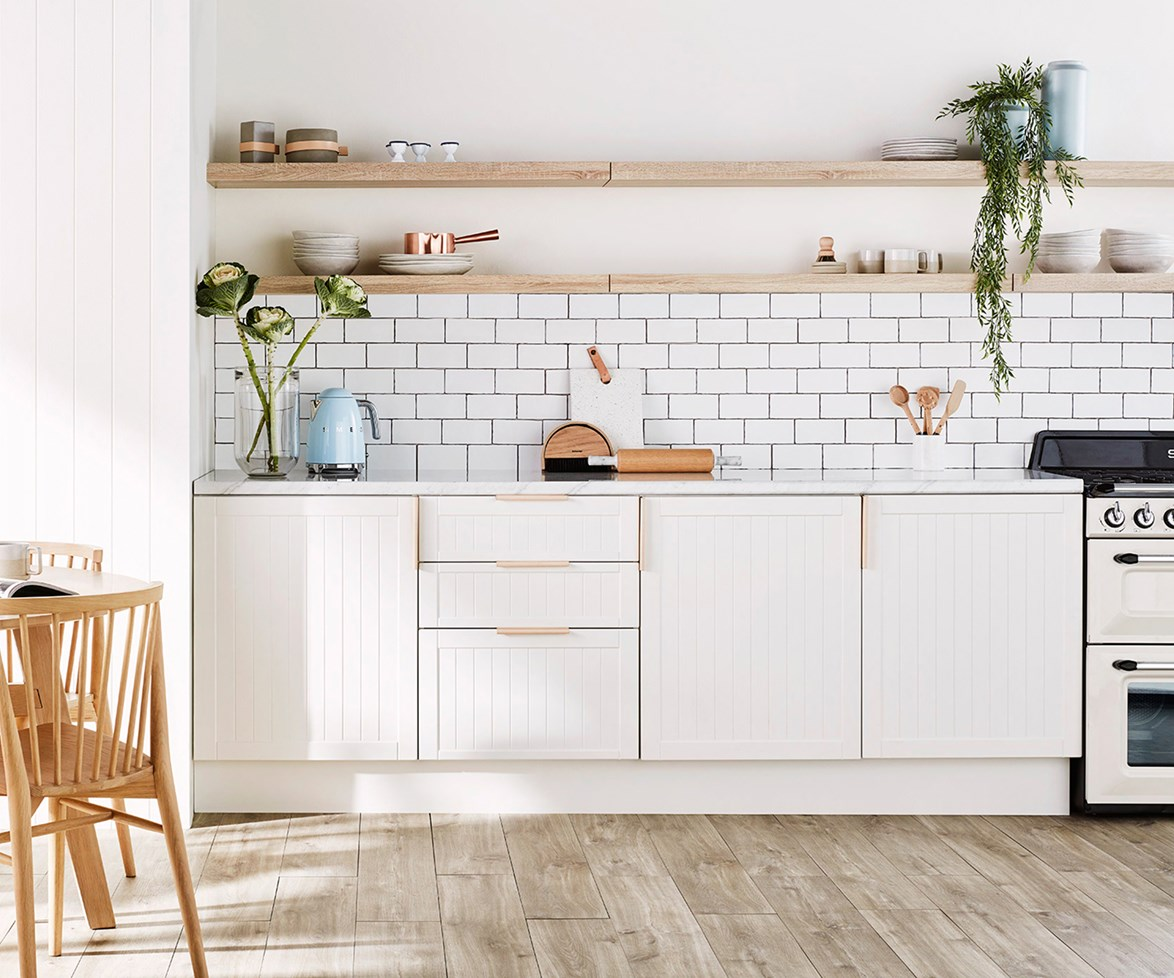 Like all interior decorating, buying an entire room from the one place will make it look like a catalogue, so vary your shopping – choose lighting and fixtures such as door handles and appliances from a variety of sources.  *Photo: Brett Stevens*
