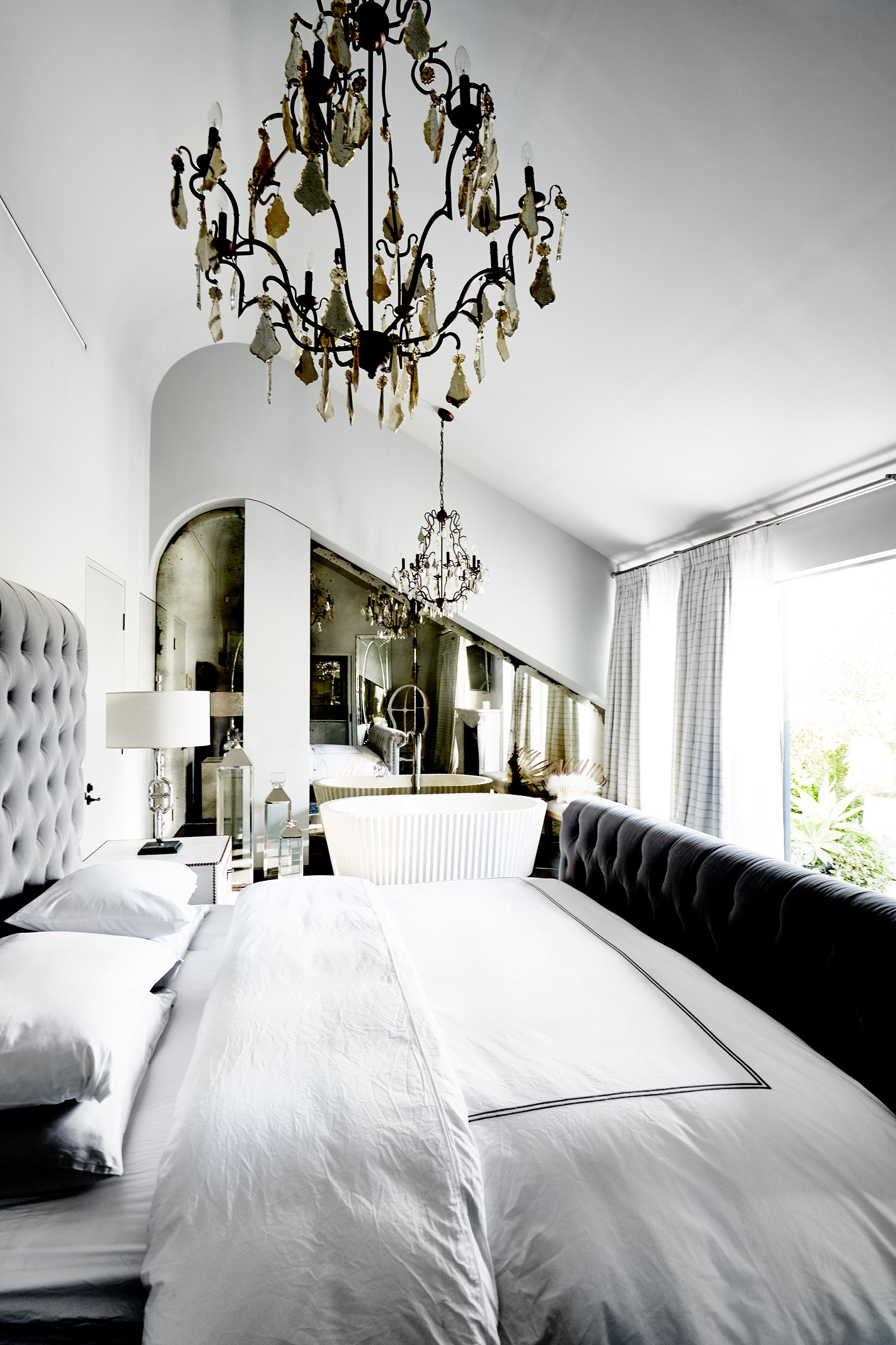 In the master bedroom of this [grand Potts Point terrace](http://www.homestolove.com.au/saraville-the-grandest-terrace-of-them-all-4215), gilded elements such as the mirror and chandeliers are purposefully aged for a rich yet restful space. *Photo: Kristina Soljo*