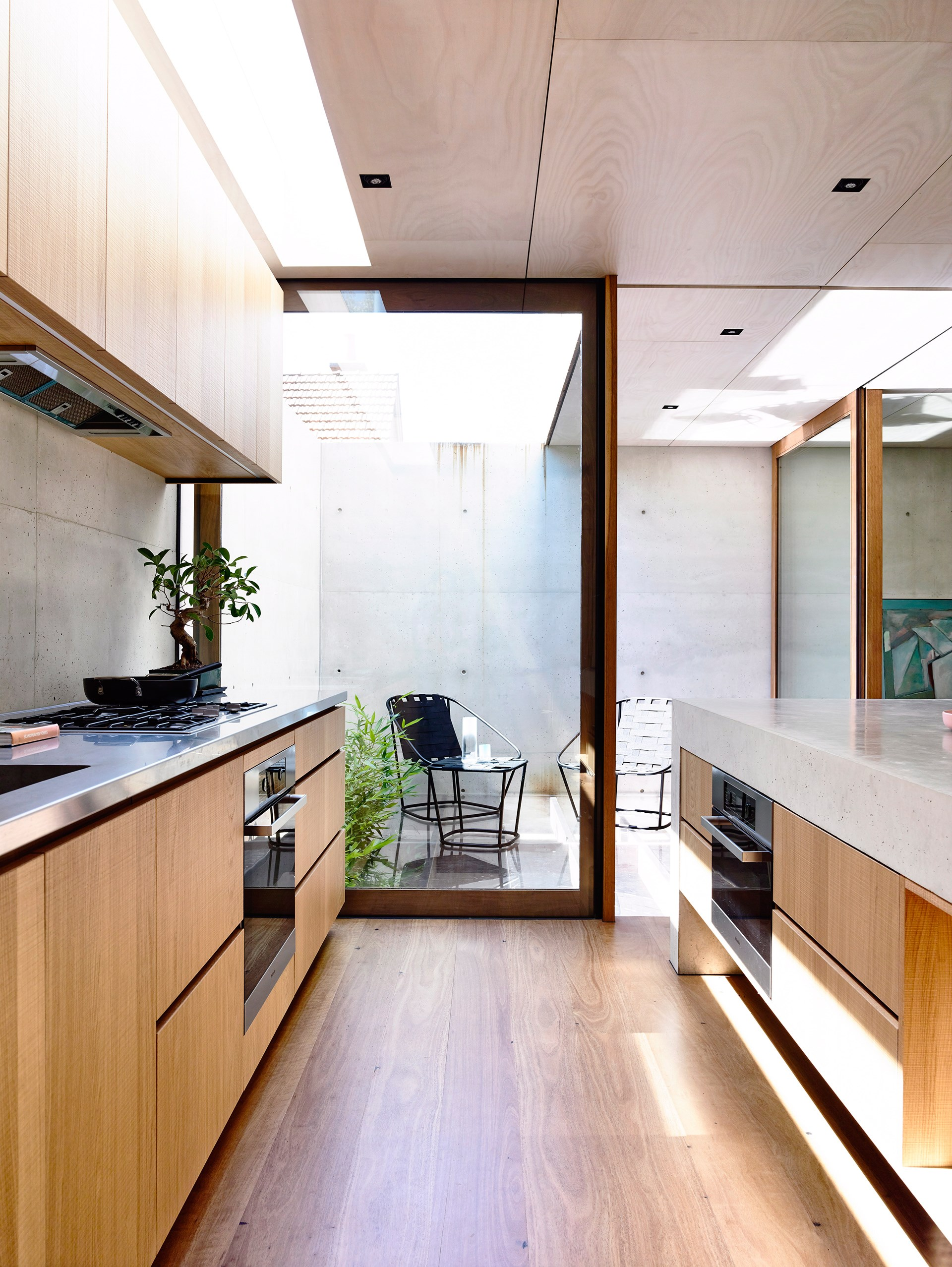 An integrated oven allows for a sleek kitchen profile, where stunning joinery steals the show. *Photo: Derek Swalwell / bauersyndication.com.au*