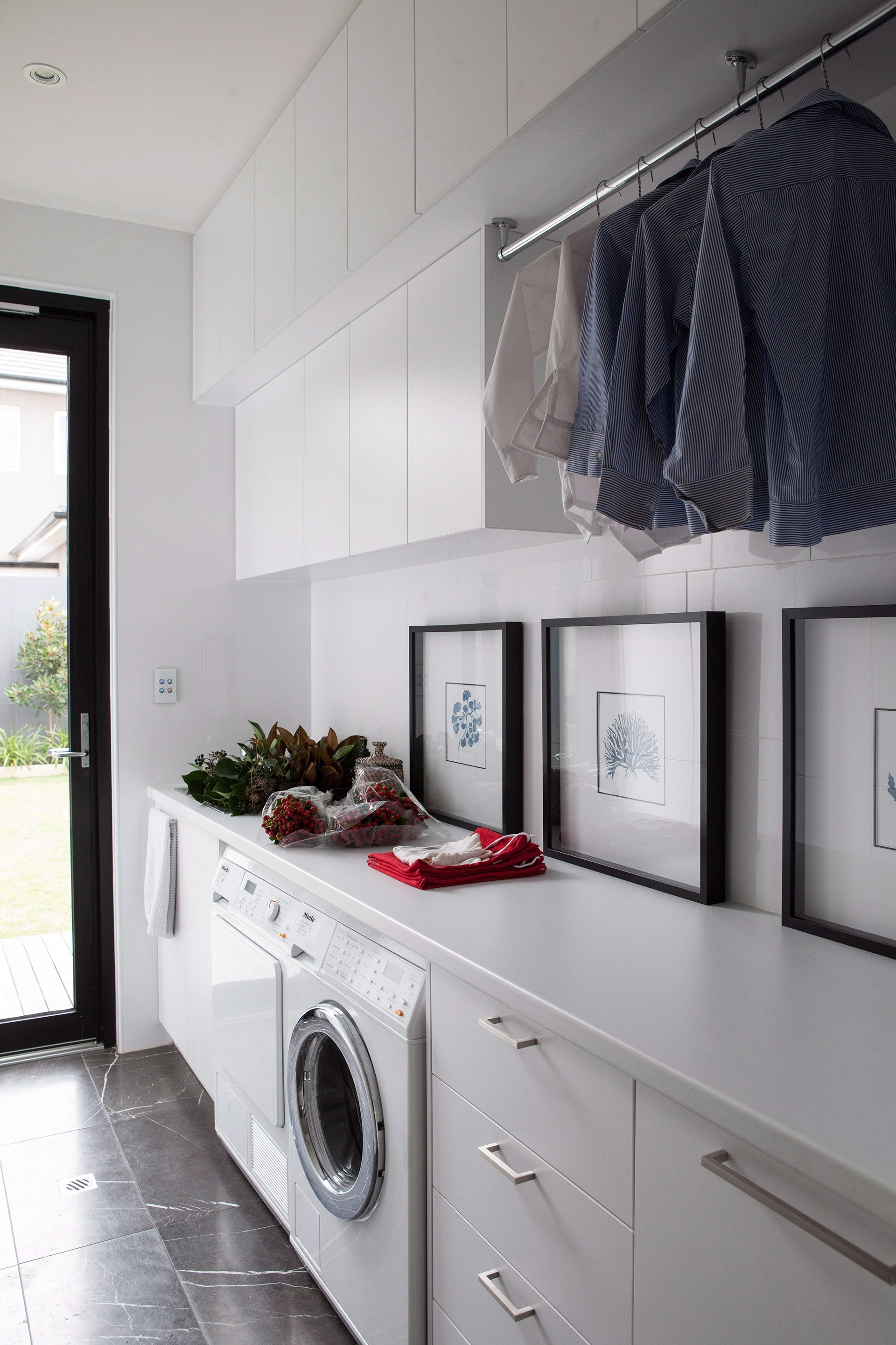 **Seamless styling:** if you can afford to, use similar finishes in the laundry as you have in the bathrooms. Also, include some decorative touches. Suddenly, you have a cosy space that feels no different to the rest of the house. *Photo: Jared Fowler / bauersydndication.com.au*