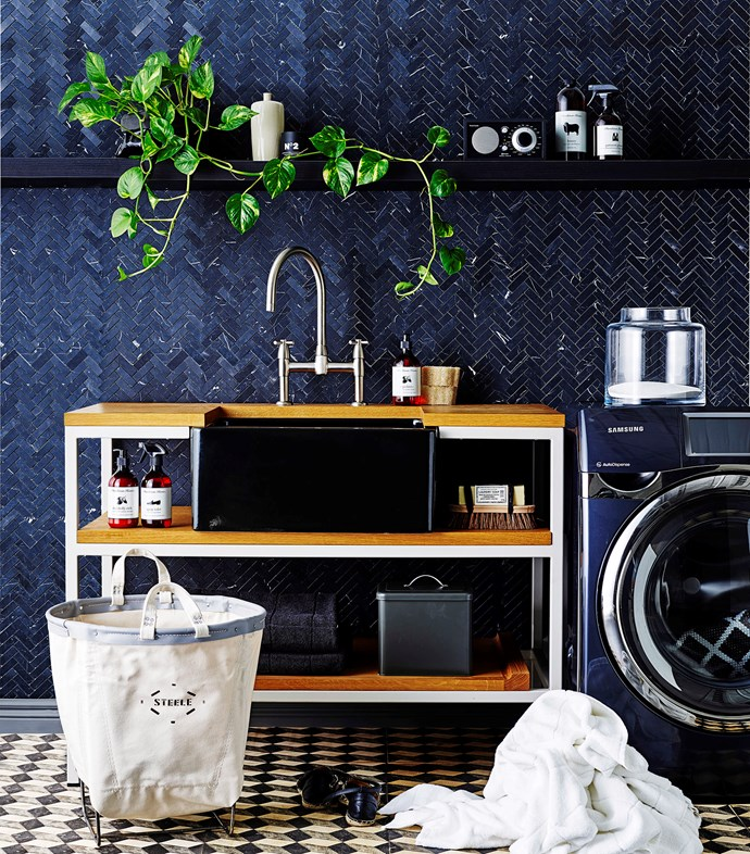 **The art of display:** open shelving is a risky move in the laundry, but will add instant personality to the room. The trick is to not get lazy – transfer laundry powder into glass jars and stash odds & ends in storage baskets. *Photo: Brett Stevens / bauersydndication.com.au*