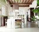 A rustic farmhouse abounds with greenery