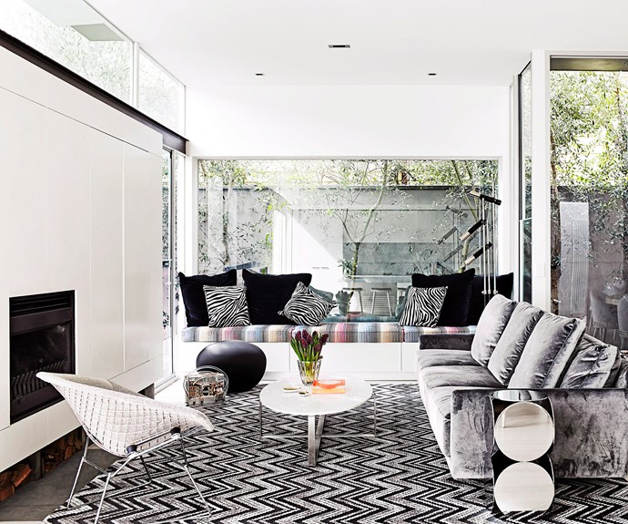 Pattern is quite at home in glam-luxe spaces. In this room designed by Sally Klopper, geometrics and organics – including zebra stripes, chevrons and diamonds – are layered, but the designer has kept a tight rein over the palette so the patterns don't go on safari. Monochrome is offset by glimpses of rainbow hues in the seat cushion and counterpoints of solid colour, such as in the shiny velvet sofa and black accents. Photo: Sharyn Cairns / bauersyndication.com.au