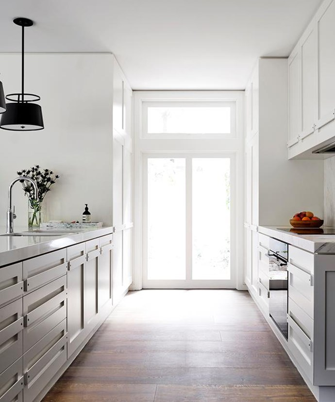 Natural light can help emphasise the spaciousness of a minimalist kitchen. *Photo: Justin Alexander / bauersyndication.com.au*