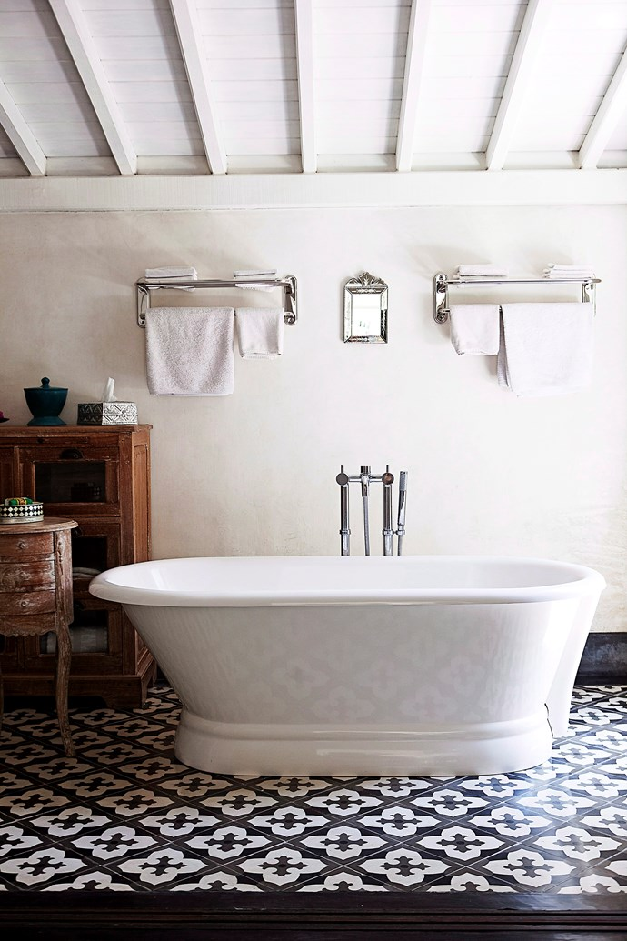 Raked ceilings combined with a freestanding bath create an authentic farmhouse feel in this bathroom. The higher the ceilings, the more spacious and barn-like a room feels. *Photo: Chris Court / bauersyndication.com.au*
