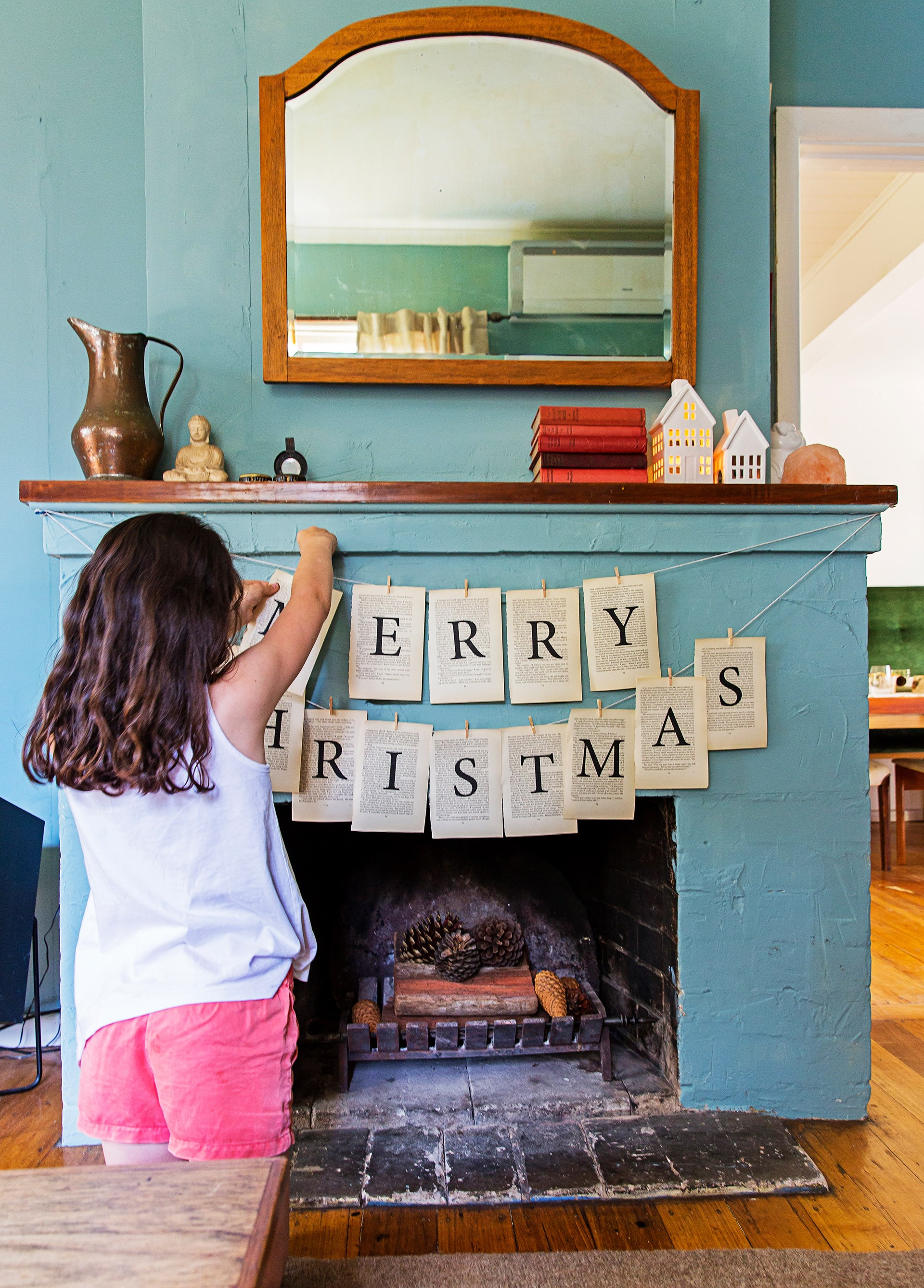 """Merry Christmas"" bunting with a vintage feel is in keeping with this [1940s weatherboard cottage in rural Victoria](http://www.homestolove.com.au/a-cottage-restoration-in-rural-victoria-4364