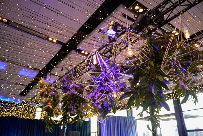 Geometric pendant lighting teamed with glittering fairy lights added ambience to the rooftop venue.